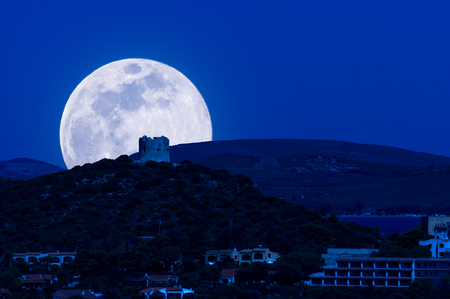 Landscape of the coast at night with super moon