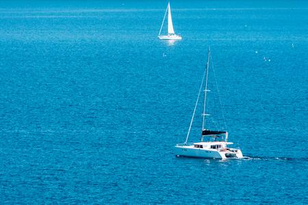 catamaran sailing in the sea in a sunny and quiet day Archivio Fotografico