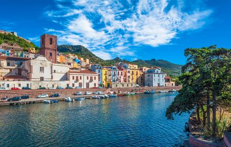 Old village of Bosa on the river Temo, in Sardinia, in a sunny and cloudy day