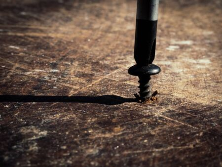 Macro of screw screwed into a  wooden table 版權商用圖片