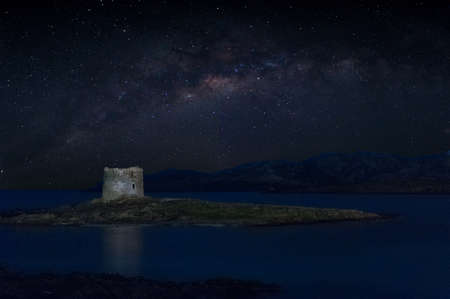 Ancient tower on the coast in sardinia at night Foto de archivo
