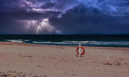 beach during the storm with lightning and dramatic cloudy sky