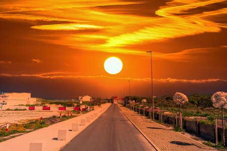 Deserted road at sunset