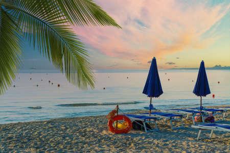 Closed umbrellas on the beach