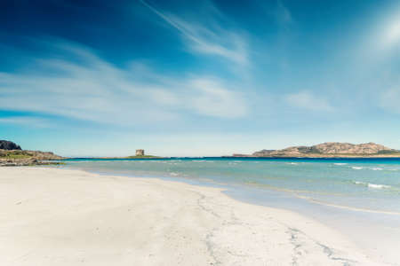 landscape of empty La Pelosa beach in a sunny day, with its white sand and clear water