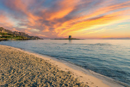 Sunrise on the beach of La Pelosa, in the small city of Stintino, with dramatic cloudy sky of summer