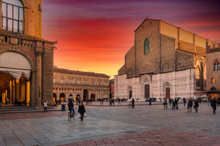 Piazza Maggiore in Bologna city under red sky of dramatic sunset