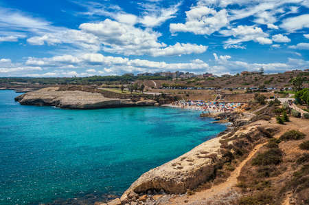 Landscape of Balai crowded beach in summer with cloudy and sunny sky