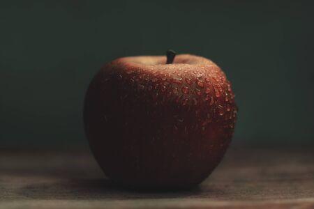 Ripe apple in drops