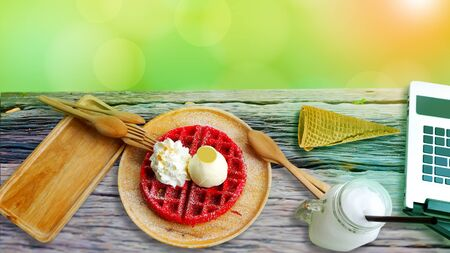 Strawberry waffle flavor served in a wooden tray with morning sun. Reklamní fotografie