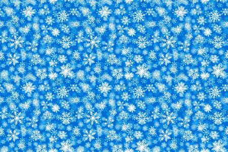 Pattern white snow flake drawing on blue background. Reklamní fotografie
