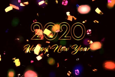 Text 2020 HAPPY NEW YEAR with golden ribbon on black background. Reklamní fotografie