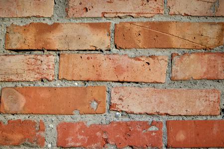 wall of old weathered brick laid horizontally masonry texture background