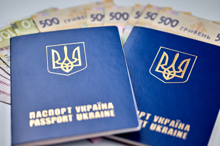 passports with national currency paper money close up view of cash on white background vacation election currency exchange voting election