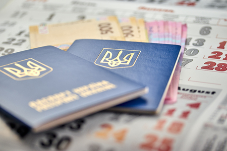 passports with national currency paper money close-up view of cash on the background of the calendar vacation election currency exchange voting election
