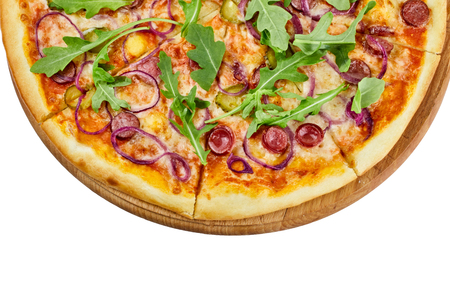 Delicious pizza with sausages mozzarella sauce cucumber and onions on a wooden board on an isolated white background restaurant menu