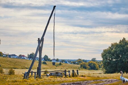 a well with a special lifting mechanism called a crane