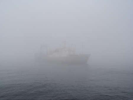 vessel drifting in the fog