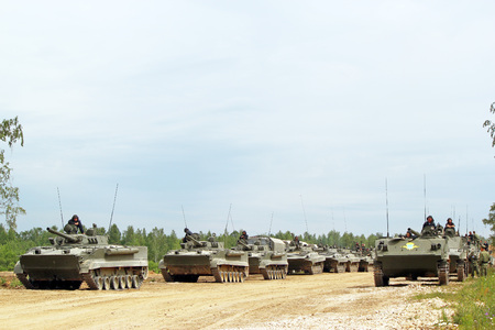 A column of Russian armored vehicles. Military training ground Alabino. Demonstrations Forum Army 2015