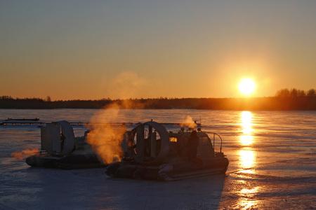 Hovercraft at sunset on Onega lake, Island Kizhi Karelia, Russia