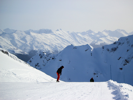 Skiers and snowboarders riding on a ski slope in Sochi mountain resort snowy winter Stock Photo