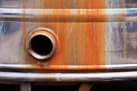 rust on tank with pipe Stock Photo