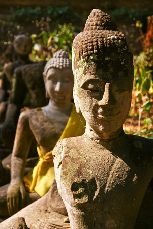 broken stone buddha image Editorial