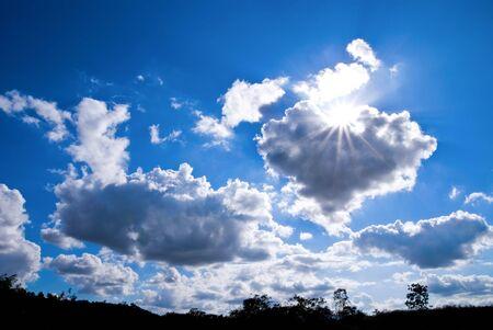 beautiful cloud, blue sky and sun ray