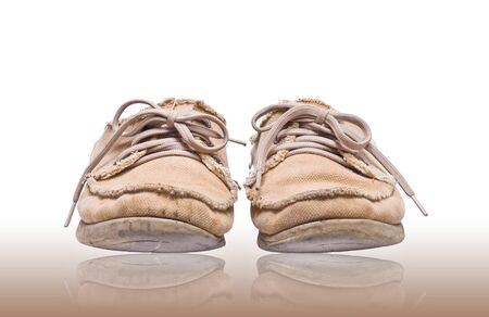 worn fabric shoe on reflect floor Stock Photo - 12859498
