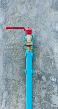 worn out faucet on concrete wall Stock Photo - 13550721