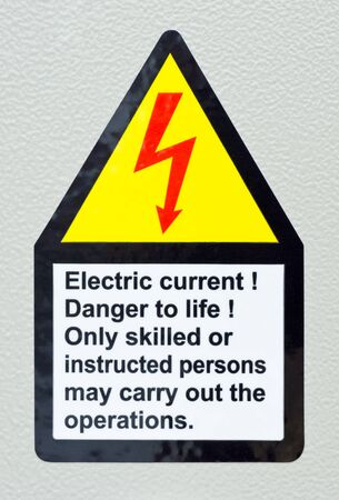 real sticker warning and notification sign about electrical photo