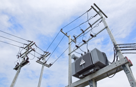 Transformer on Electric Pole and Power transmission lines Stock Photo