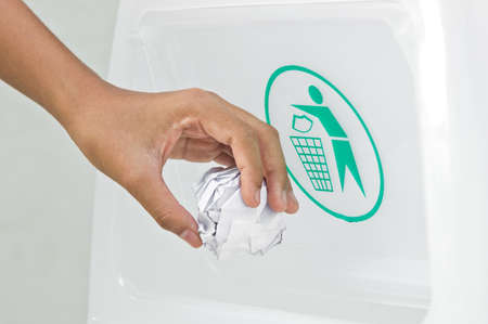 hand putting a paper garbage into litter bin Stock Photo - 18587031