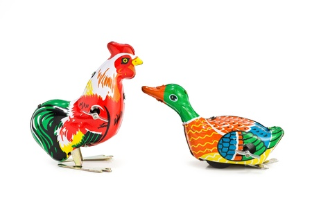 antique tin toy chicken and duck on white background