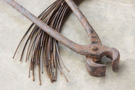 old nippers or pincers with metal wire Stock Photo - 19582840