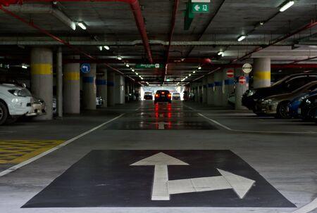 multi story car park: traffic arrow on the floor  of car park building
