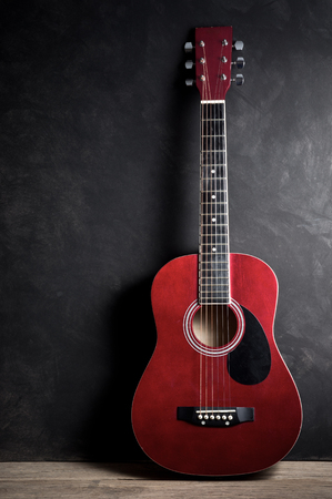 Still life photography, Old acoustic guitar on dark background photo