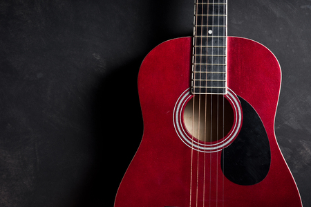 Still Life Photography Part Of Old Acoustic Guitar On Dark Background Photo