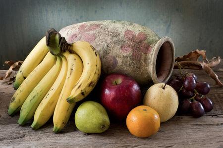 still life photography , many fruit with old vase Stock Photo
