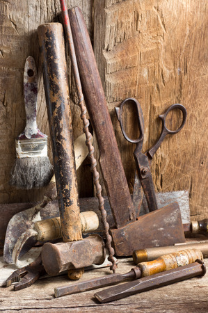 Still life photography, many working tools on old wood background