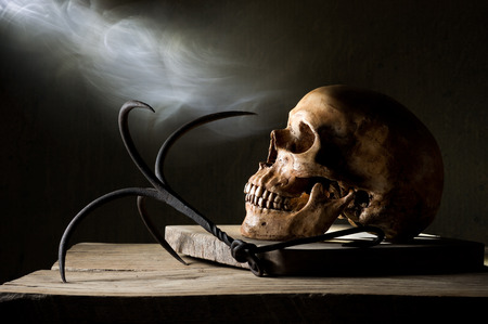 Still life photography, Human skull with steel hook and smoke, in dreadful human soul concept