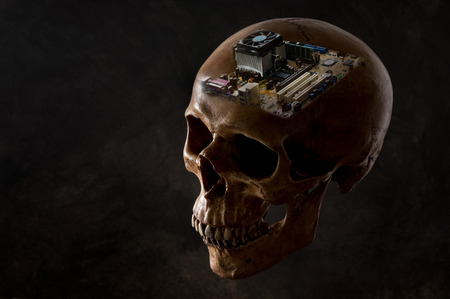 human skull image editing with a computer motherboard on dark background in genius concept Stock Photo