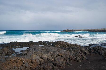 smashing: Waves smashing on black rocks in tenerife