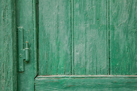 recently: Recently painted green wood door and window panels with hinge Stock Photo