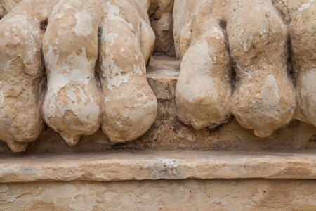 ancient lion: Rocky and ancient lion feet damaged by the weather Stock Photo