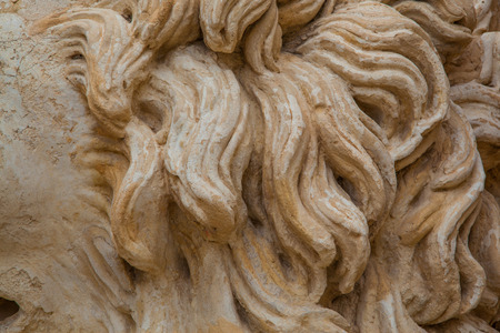 ancient lion: Rocky and ancient lion mane damaged by the weather