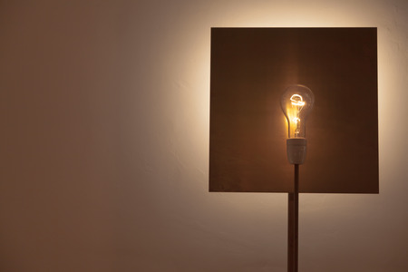 copper background: A lamp made with a lamp over a square shaped copper background Stock Photo
