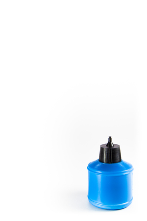 pva: plastic blue  glue container isolated on white
