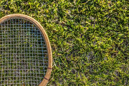 raquet: Vintage wood tennis racket on grass garden
