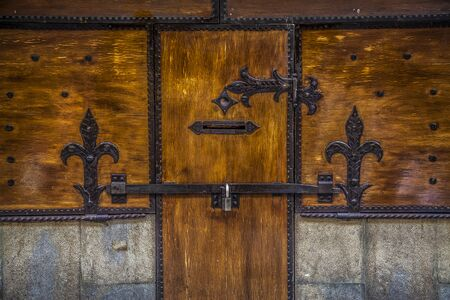 medioeval: Italian style wood medioeval ancient door with lock and friezes